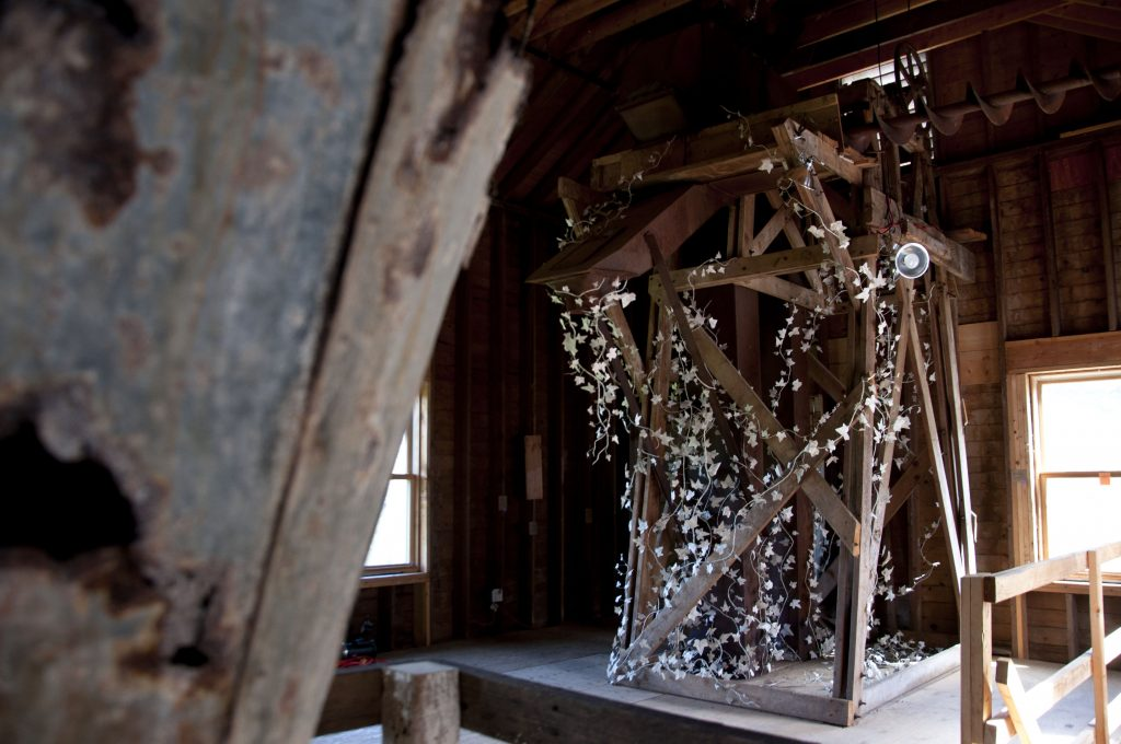 """Climbing ivy, Wassaic"" Site-specific Installation, completed during a residency at the Wassaic Project, Size: 7' W. x 13' hgt. x 7' depth (materials: local newspapers, iron wire, masking tape), 2013."